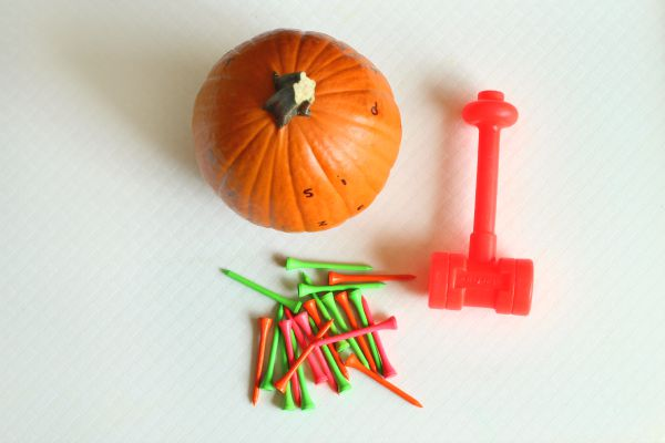 Pounding golf tees into pumpkins while learning letters.