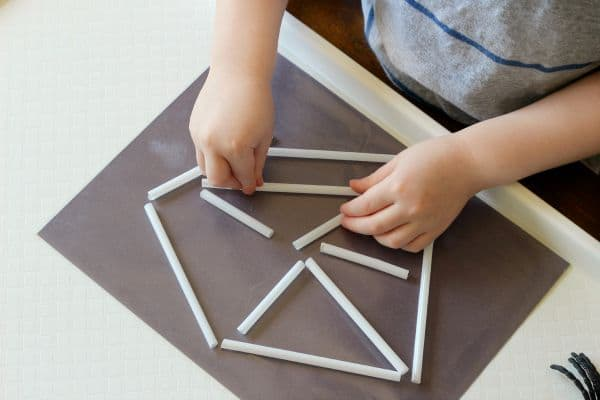 Make a spider web with straws