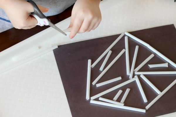 Cutting straws and sticking them to contact paper