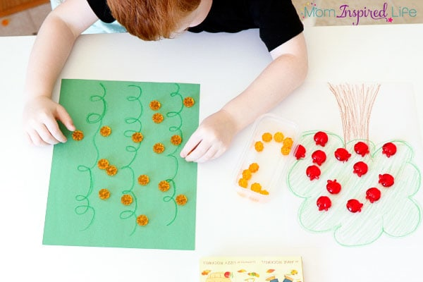 Teaching kids to sort items with apples and pumpkins.