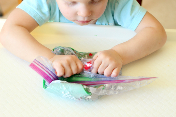Decorate the Christmas tree sensory activity for fine motor development.