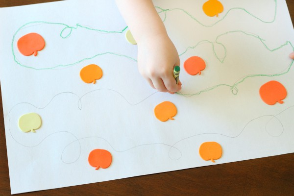 Tracing curved lines for handwriting practice. A fun pumpkin writing activity.