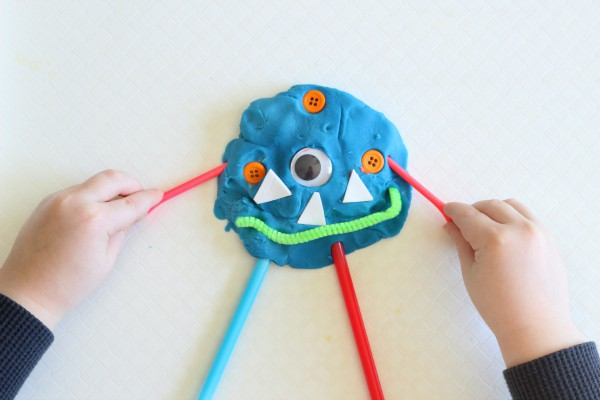 Roll the dice and add parts to your monster! A fun fine motor activity for preschoolers.