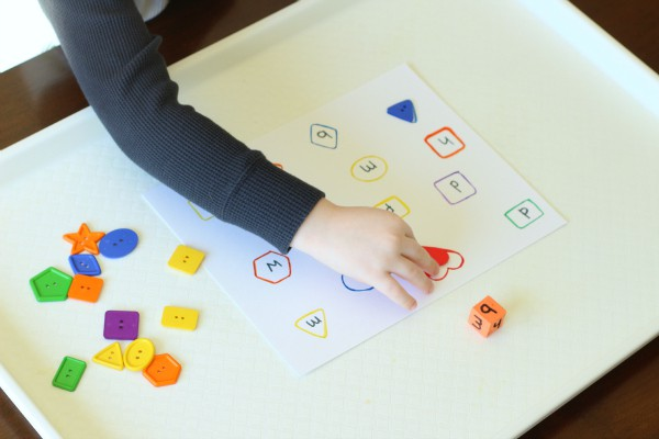 Learning shapes and colors with a fun alphabet activity.
