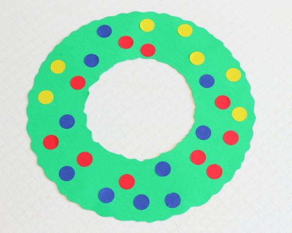 Christmas wreath craft activity for fine motor skills development.