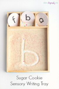 Writing Letters in a Sugar Cookie Sensory Tray