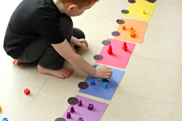 Sorting colors and counting with a hands-on train activity.