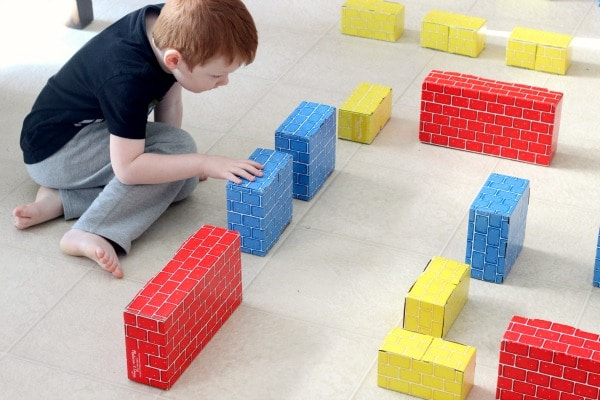 Building a maze with cardboard blocks. STEM maze activity.