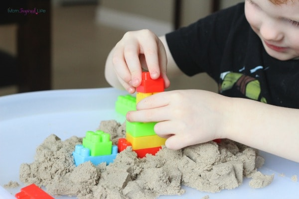 Blocks in kinetic sand activity for toddlers and preschoolers.