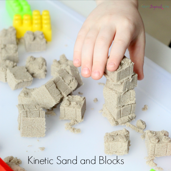 Playing with kinetic sand and blocks. A fun engineering challenge for kids!