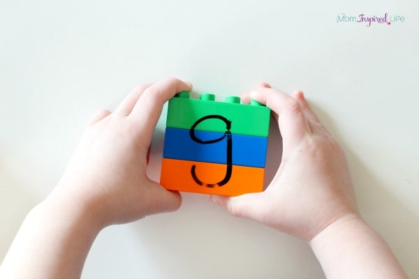LEGO puzzle activity for learning letters.