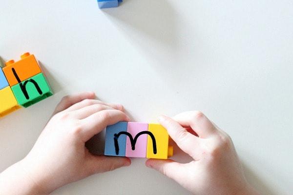 LEGO alphabet puzzle activity.