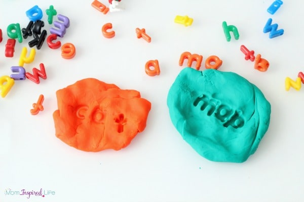 Alphabet bead stamping in play dough. Hands-on literacy.