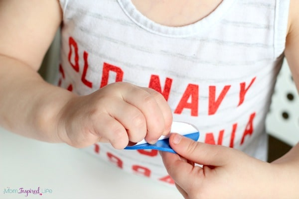 Peeling stickers is a great fine motor activity for toddlers!