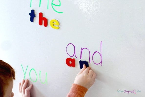 Learning sight words with magnetic alphabet letters.