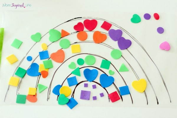 Sticky rainbow shape activity for toddlers. A fun shape and color learning activity.