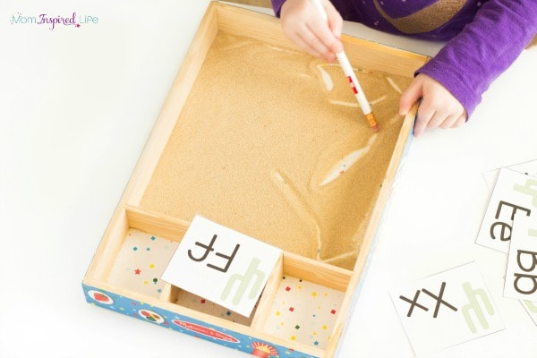 Sand tray for toddlers. A fun way to develop pre-writing skills and engage in a sensory experience.