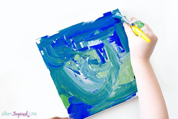 Tape or sticker resist paintings that kids can make for Father's Day.