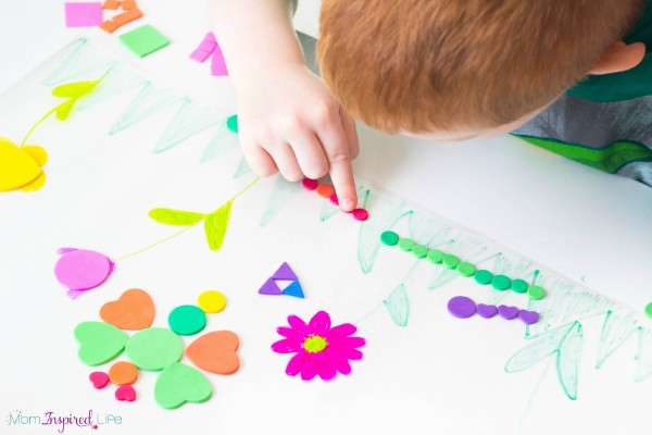 Making bugs on a sticky spring scene is a fun way for preschoolers to develop critical thinking skills!
