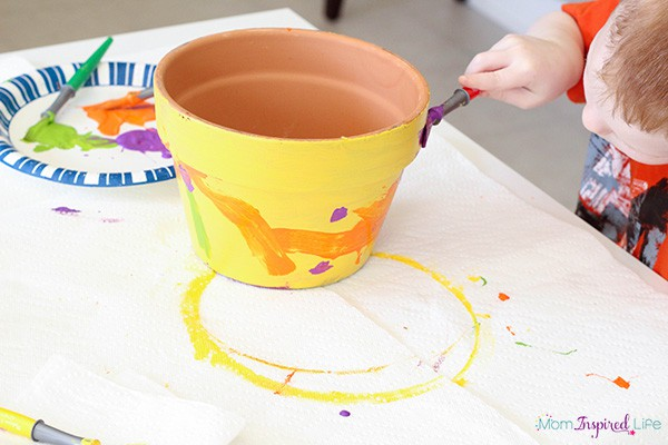Painting flower pots and planters art activity for young kids.