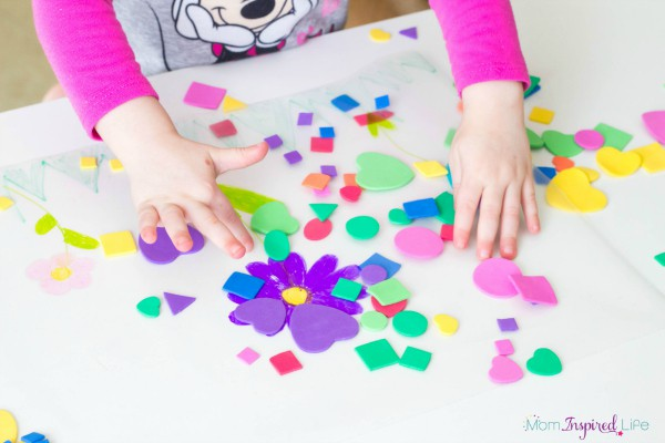 This sticky shapes spring scene is a fun way for toddlers to learn about shapes!