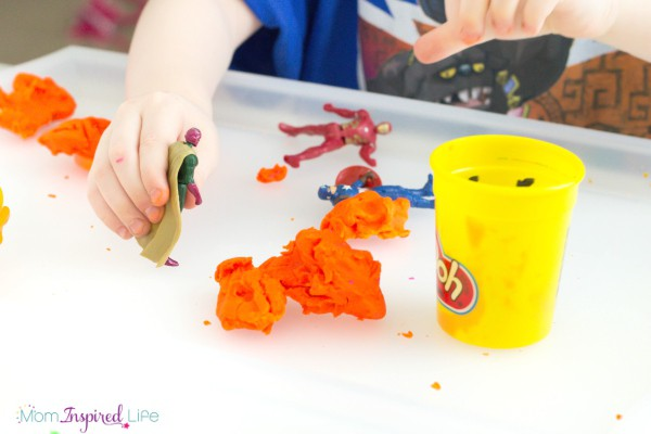 A play dough activity that uses superheroes to engage preschoolers and encourage them to develop fine motor skills.