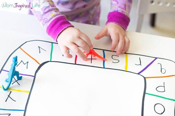 Dinosaur alphabet activity for preschoolers. A hands-on alphabet board game.