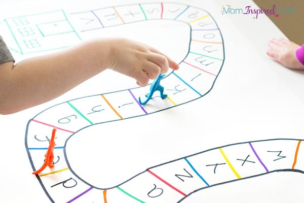Teaching the alphabet with a BIG alphabet board game! Kids love this exciting dinosaur themed alphabet activity!
