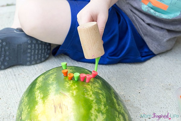 This summer activity for kids is so much fun! Let them smash watermelon rinds with a hammer!