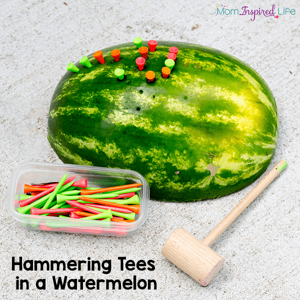 Hammering tees into watermelons for fine motor practice.