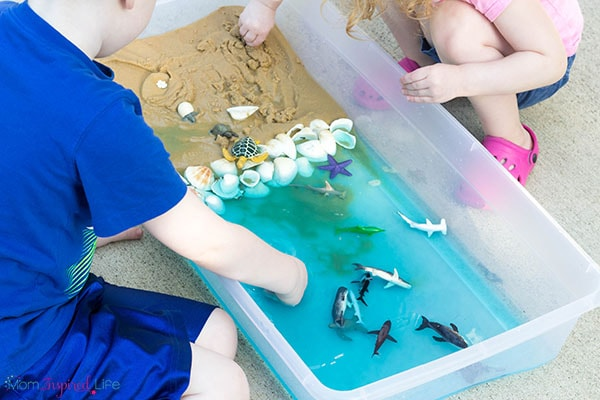 Sand and water ocean sensory play for kids. A fun way to learn about ocean animals and the ocean habitat this summer.