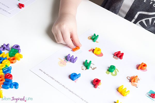Literacy center idea for kindergarten. A hands-on way to learn letter sounds.
