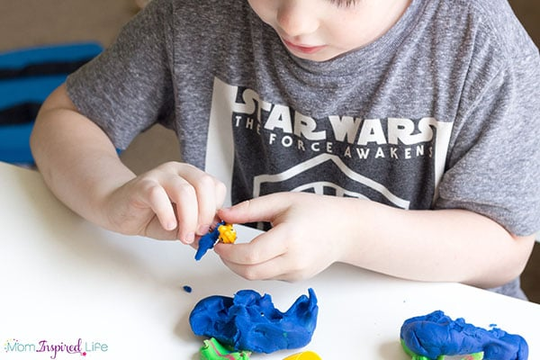 A super cool dinosaur eggs play dough activity for preschoolers.