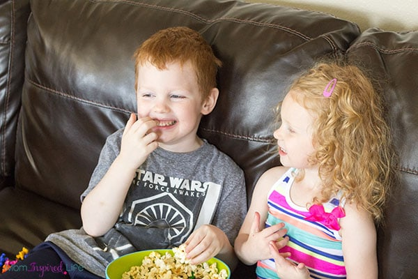 This sweet and salty dinosaur popcorn snack mix is perfect for family movie night!