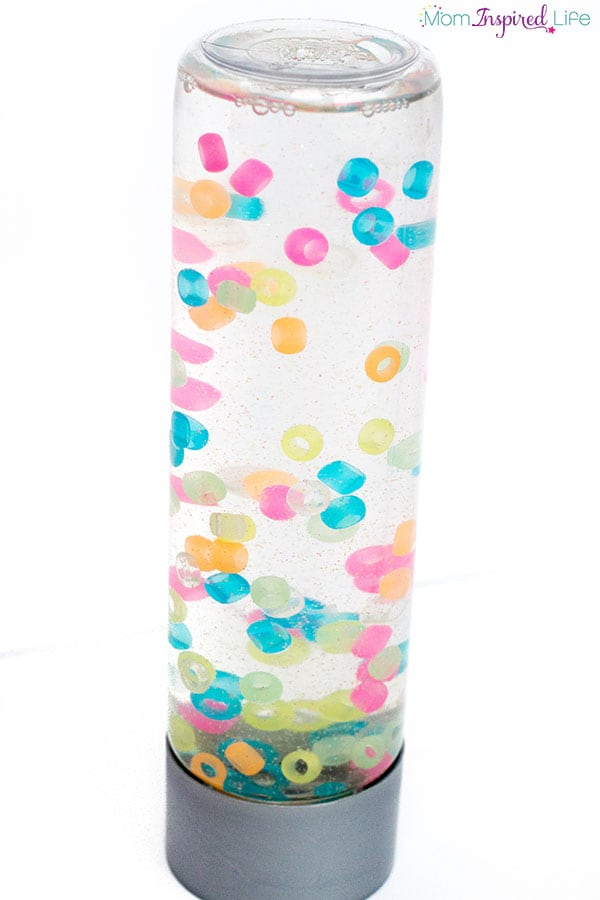 This colorful sensory bottle with beads is super cool to look at. A neat calm down bottle.