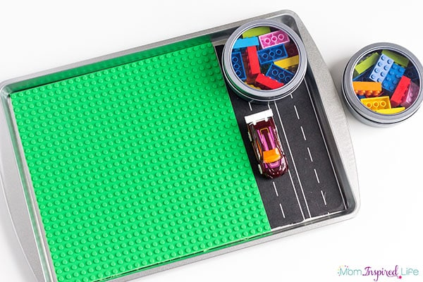 DIY travel tray for kids that is cheap and easy to make. It is an awesome travel activity tray for kids to use!