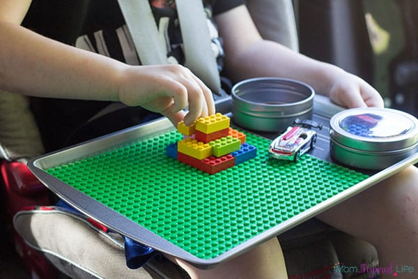 Make road trips and plane fights bearable with this fun portable LEGO travel tray! A super fun travel activity for kids!