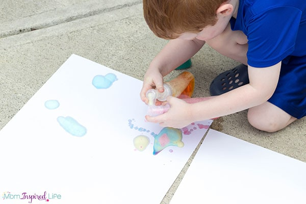 Developing fine motor skills with soap pumps and soap foam.