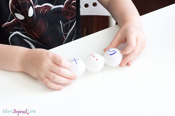 Making words out of ping pong balls is an awesome hands-on literacy activity that is perfect for your literacy center!