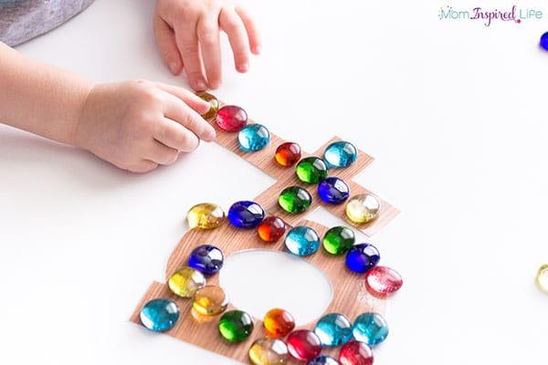 Teach the alphabet with this tactile alphabet activity.