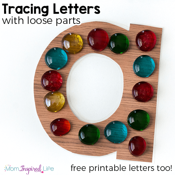 Alphabet letter tracing activity with loose parts.