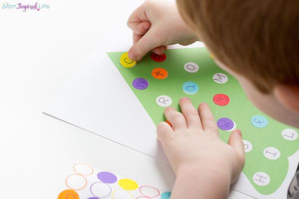 A Christmas fine motor alphabet activity for preschool.