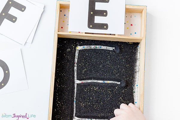 Space theme or star theme writing tray for kids.