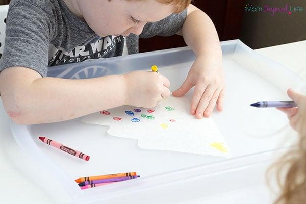 Christmas tree crayon resist art activity for kids.