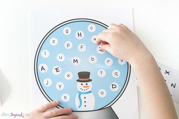 Learning letters with a snowman alphabet activity.