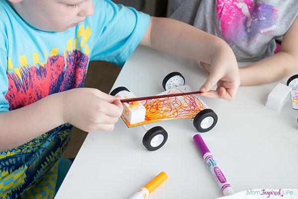 Designing balloon cars with a fun STEM kit.