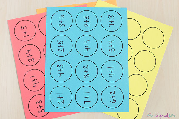 Math facts activity with paper cups. A free printable mat makes it even easier to do.