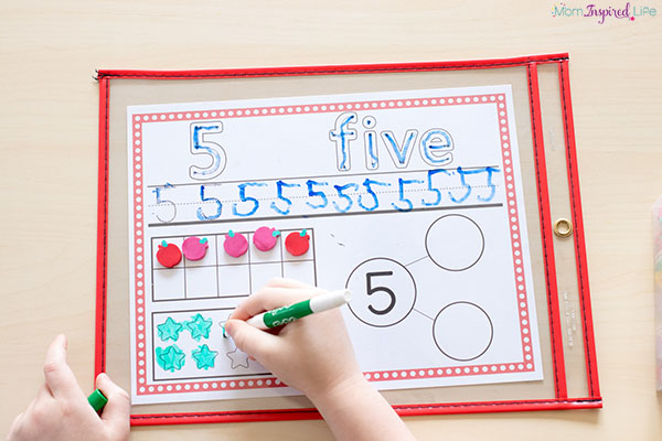 These number sense activity mats teach kids to write numbers, use a ten frame, engage with number bonds and base ten blocks.