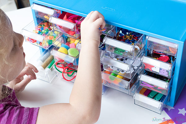 Organizing kids craft supplies in by using this arts and crafts supply center.