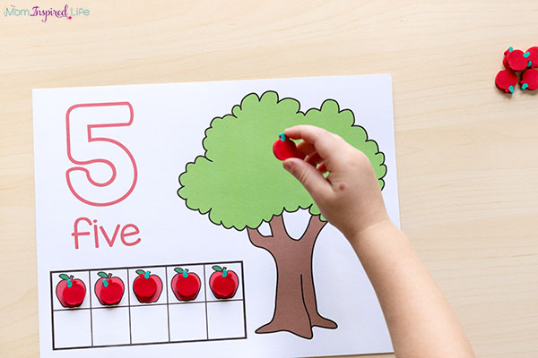 Learning to count with a fun apple themed math activity.